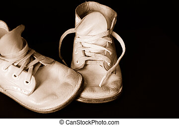 Sepia Vintage Baby Shoes - Vintage baby shoes over black. ...