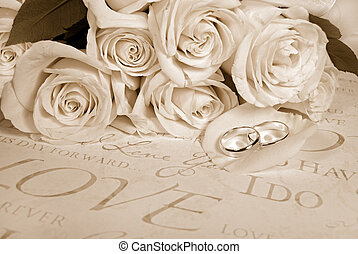 Sepia Wedding - Wedding rings on rose petal with boquet in...