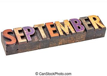 September banner - isolated word in vintage letterpress wood type - calendar concept