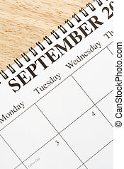 September on calendar. - Close up of spiral bound calendar...