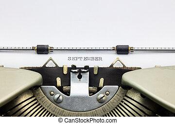 September word in capital letters on white sheet