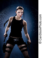 A young woman dressed like the tomb raider
