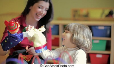 sequence of female teacher and little girl playing in kindergarten