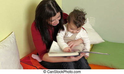 Sequence of Female Teacher Reading Book To Little Girls