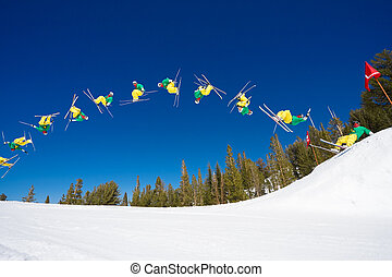 Sequence of Skier doing Radical Back Flip off Jump