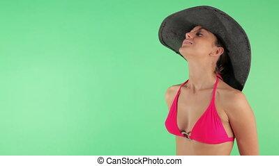 Sequence of young woman in bikini