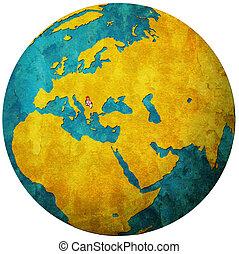 serbia flag on globe map