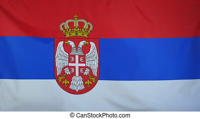 Serbia Flag real fabric close up - Textile flag of Serbia...