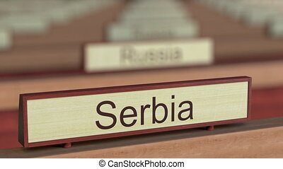 Serbia name sign among different countries plaques at...