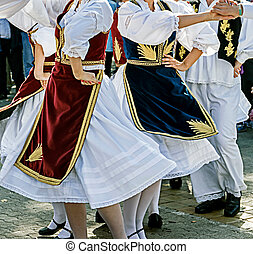 Serbian Dance - Dancers in traditional costumes who perform ...