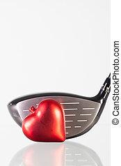 serce, golfowy klub, szklany stół, czerwony