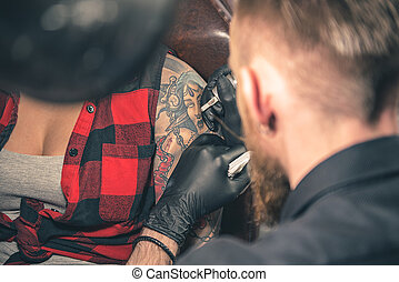 Serene bearded male doing picture on arm