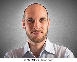 Serene businessman - Portrait of businessman smiling serene...