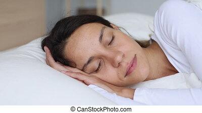 Serene calm young mixed race woman sleeping well. - Serene ...