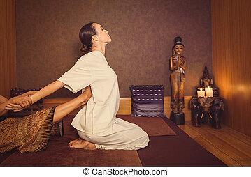 Serene girl enjoying thai massage - Professional thai...