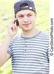 Serene guy with phone