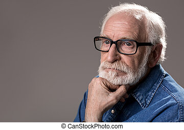 Serene hoary pensioner with pensive face - Portrait of...