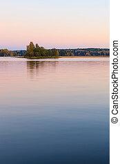 Serene lake scenery at dusk in Finland