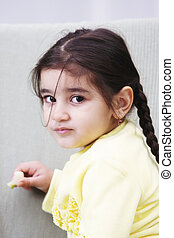 Serene little girl in yellow