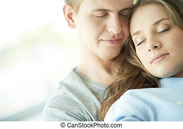 Serene lovers - Young couple enjoying presence of one ...
