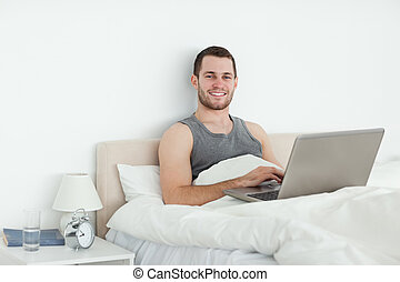 Serene man using a laptop