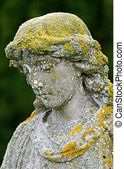 Serene statue - An old stone statue with a poignant...