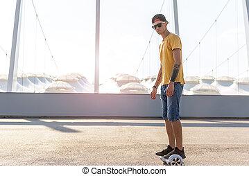 Serene teenager going on digital device