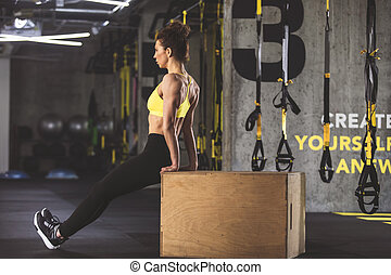 Serene woman making physical exercise