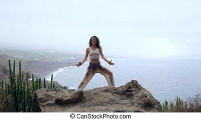 Serenity and yoga practicing at mountain range,meditation. -...