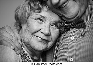Serenity - Black-and-white image of senior female being...