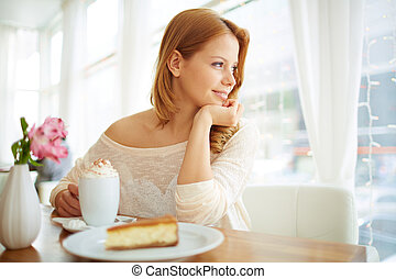Serenity - Image of serene girl sitting in cafe and looking...
