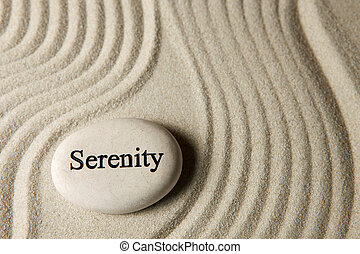 Inspirational stone surrounded by sand ripples. Zen concept