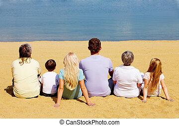 Serenity - Photo of serene family members sitting on sandy...