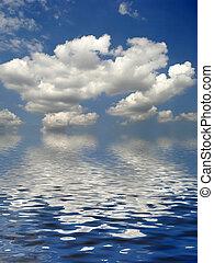 Serenity - White fluffy clouds cumulus nimbus against a blue...