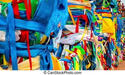Serge. Sacred poles with colored ribbons in island Olkhon. Burkhan, Lake Baikal