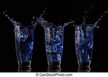 Serial arrangement of blue liquid splashing in glass