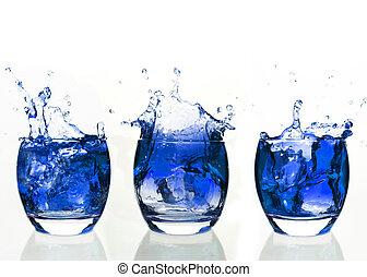 Serial arrangement of blue liquid splashing in tumbler