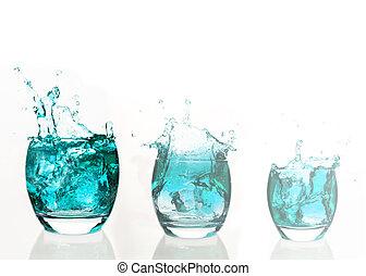 Serial arrangement of pale blue liquid splashing in tumbler
