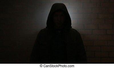 Serial killer in the dark breathing heavily waiting for the...