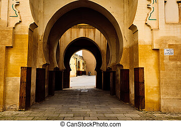 Series of Moorish style curving arches of passageway into courtyard