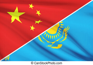 Flags of China and Republic of Kazakhstan blowing in the wind. Part of a series.