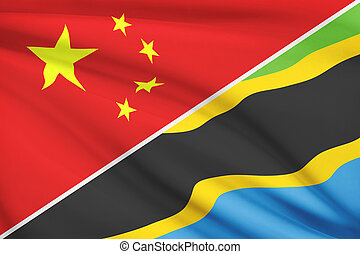 Flags of China and United Republic of Tanzania blowing in the wind. Part of a series.