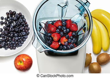 Series of shots. Photo 6. Strawberries and blueberries in a blender.