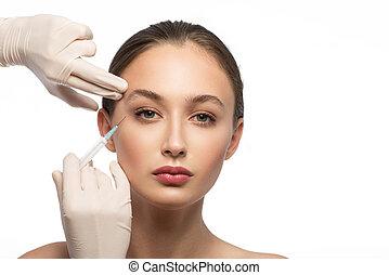Serine woman receiving botox injection
