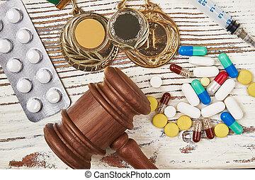 seringue, pills., médailles, marteau