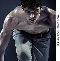 serio, muscular, joven, preparando, para correr