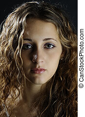 Serious - A serious portrait of an attractive female model