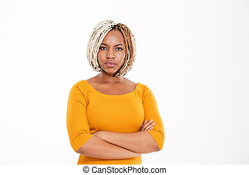 Serious african american woman standing with arms crossed