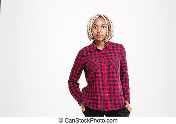 Serious african american woman with braids in checkered shirt