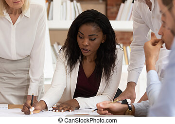 Serious african female leader explain paperwork write notes sign paper